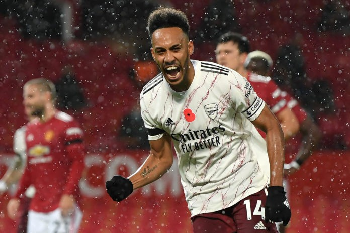 Arsenal's Gabonese striker Pierre-Emerick Aubameyang celebrates after scoring the opening goal from the penalty spot during the English Premier League football match between Manchester United and Arsenal at Old Trafford in Manchester, north west England, on November 1, 2020. (Photo by Shaun Botterill / POOL / AFP)