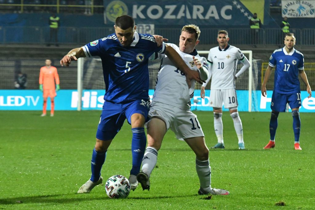Bosnia and Herzegovina's defender Sead Kolasinac (L) vies with Northern Ireland's forward Kyle Lafferty (R) during the UEFA Euro 2020 Play-off Semi-Final football match between Bosnia and Herzegovina and Northern Ireland in Sarajevo on October 8, 2020. (Photo by ELVIS BARUKCIC/AFP via Getty Images)