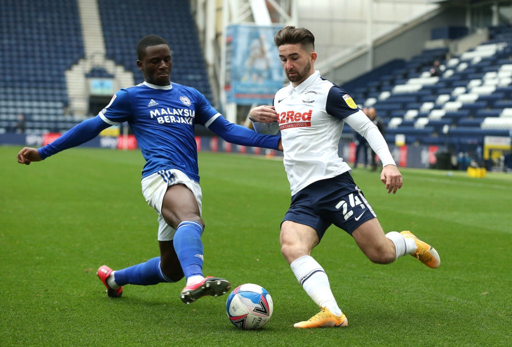 PRESTON, ENGLAND - OCTOBER 18: Jordi Osei-Tutu challenges Sean Maguire of Preston North End during the Sky Bet Championship match between Preston North End and Cardiff City at Deepdale on October 18, 2020. (Photo by Lewis Storey/Getty Images)