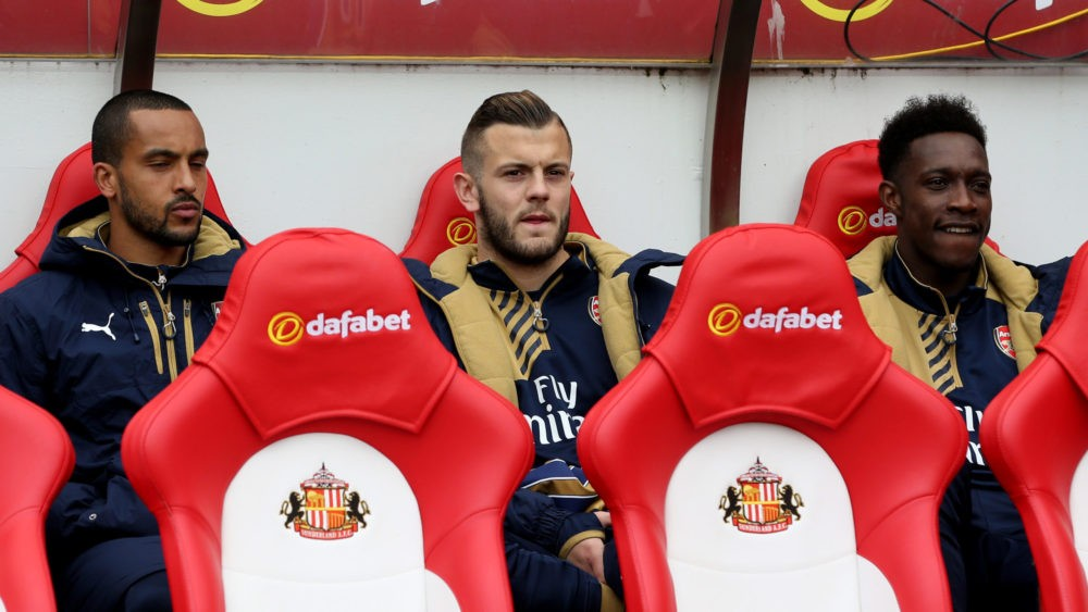 SUNDERLAND, ENGLAND - APRIL 24: (L-R) Substitutes Theo Walcott, Jack Wilshere and Danny Welbeck of Arsenal look on from the bench during the Barclays Premier League match between Sunderland and Arsenal at the Stadium of Light on April 24, 2016 in Sunderland, United Kingdom. (Photo by Jan Kruger/Getty Images)