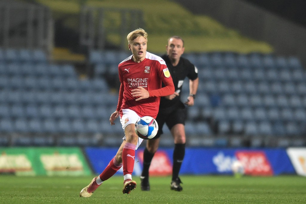 Swindon Town Midfielder Matthew Smith plays a pass during the EFL Sky Bet League 1 match between Oxford United and Swindon Town at the Kassam Stadium, Oxford, England on 28 November 2020. Copyright: Marek Dorcik