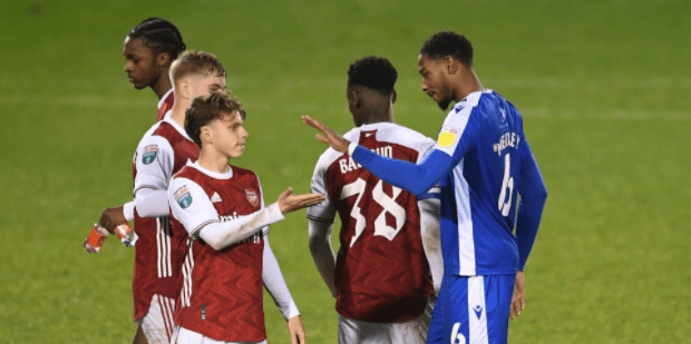Zech Medley (R) after his loan game with Gillingham against the Arsenal u21s. Medley is greeting Arsenal's Ben Cottrell. (Photo via Getty Images)