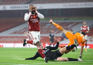 LONDON, ENGLAND - NOVEMBER 08: Alexandre Lacazette of Arsenal reacts after a missed chance during the Premier League match between Arsenal and Aston Villa at Emirates Stadium on November 08, 2020 in London, England. Sporting stadiums around the UK remain under strict restrictions due to the Coronavirus Pandemic as Government social distancing laws prohibit fans inside venues resulting in games being played behind closed doors. (Photo by Richard Heathcote/Getty Images)