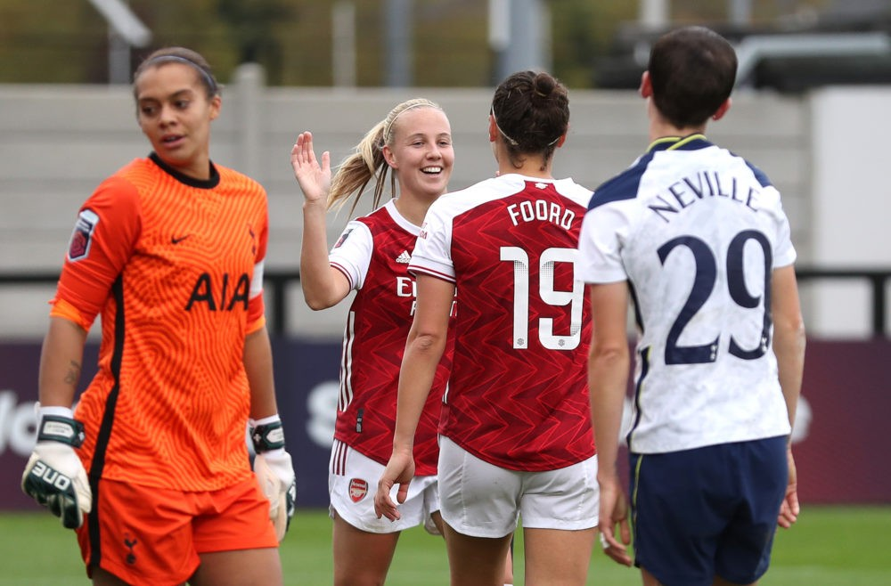 BOREHAMWOOD, ENGLAND - OCTOBER 18: Caitlin Foord of Arsenal celebrates with teammates Beth Mead after scoring her team's sixth goal during the Barclays FA Women's Super League match between Arsenal Women and Tottenham Hotspur Women at Meadow Park on October 18, 2020 in Borehamwood, England. Sporting stadiums around the UK remain under strict restrictions due to the Coronavirus Pandemic as Government social distancing laws prohibit fans inside venues resulting in games being played behind closed doors. (Photo by Catherine Ivill/Getty Images)