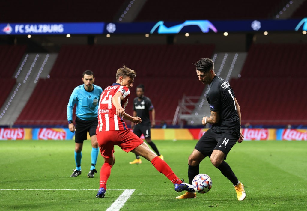 MADRID, SPAIN: Marcos Llorente of Atletico de Madrid battles for possession with Dominik Szoboszlai of RB Salzburg during the UEFA Champions League Group A stage match between Atletico Madrid and RB Salzburg at Estadio Wanda Metropolitano on October 27, 2020. (Photo by Angel Martinez/Getty Images)