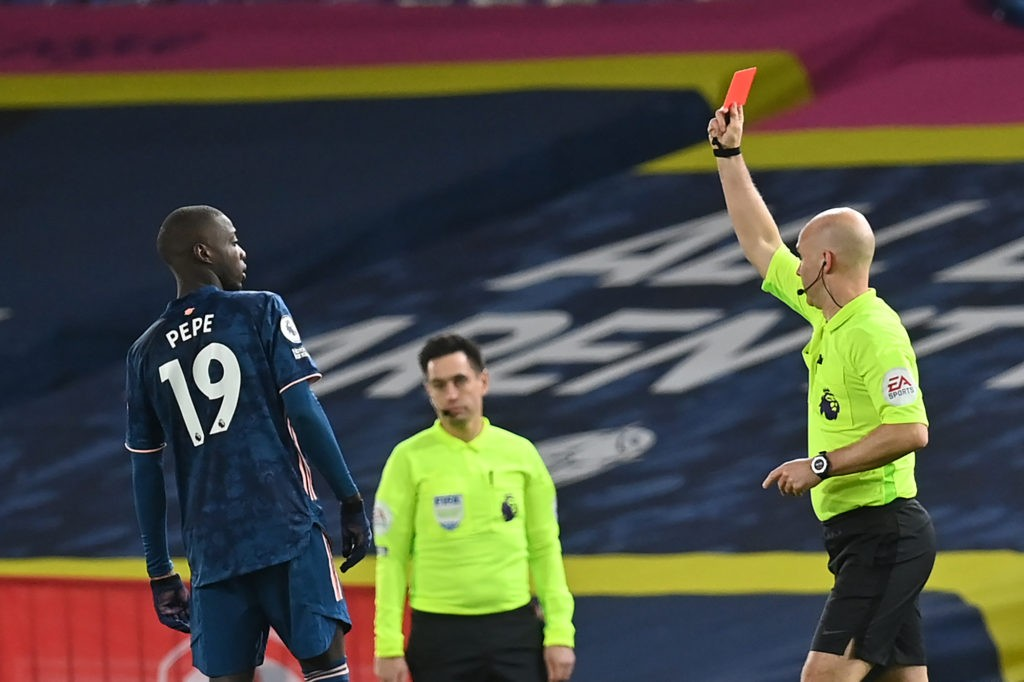 Arsenal's French-born Ivorian midfielder Nicolas Pepe (L) is shown a red card by atch Referee Anthony Taylor (R) during the English Premier League football match between Leeds United and Arsenal at Elland Road in Leeds, northern England on November 22, 2020. (Photo by Paul ELLIS / POOL / AFP)