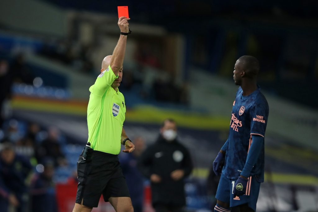 English referee Anthony Taylor shows a red card to Arsenal's French-born Ivorian midfielder Nicolas Pepe (R) after he clashes with Leeds United's Macedonian midfielder Ezgjan Alioski during the English Premier League football match between Leeds United and Arsenal at Elland Road in Leeds, northern England on November 22, 2020. (Photo by MOLLY DARLINGTON / POOL / AFP)