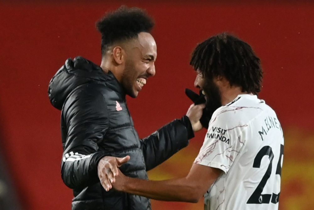 Arsenal's Gabonese striker Pierre-Emerick Aubameyang (L) celebrates with Arsenal's Egyptian midfielder Mohamed Elneny (R) at the end of the English Premier League football match between Manchester United and Arsenal at Old Trafford in Manchester, north west England, on November 1, 2020. (Photo by Shaun Botterill / POOL / AFP)
