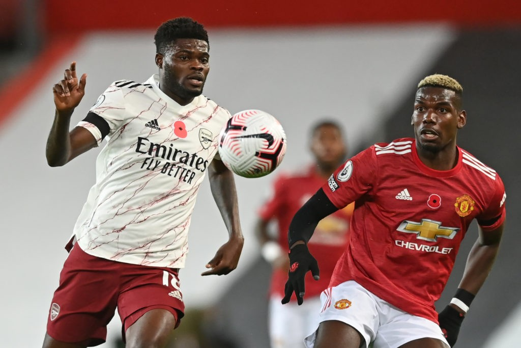 Arsenal's Ghanaian midfielder Thomas Partey (L) vies with Manchester United's French midfielder Paul Pogba (R) during the English Premier League football match between Manchester United and Arsenal at Old Trafford in Manchester, north west England, on November 1, 2020. (Photo by Shaun Botterill / POOL / AFP)