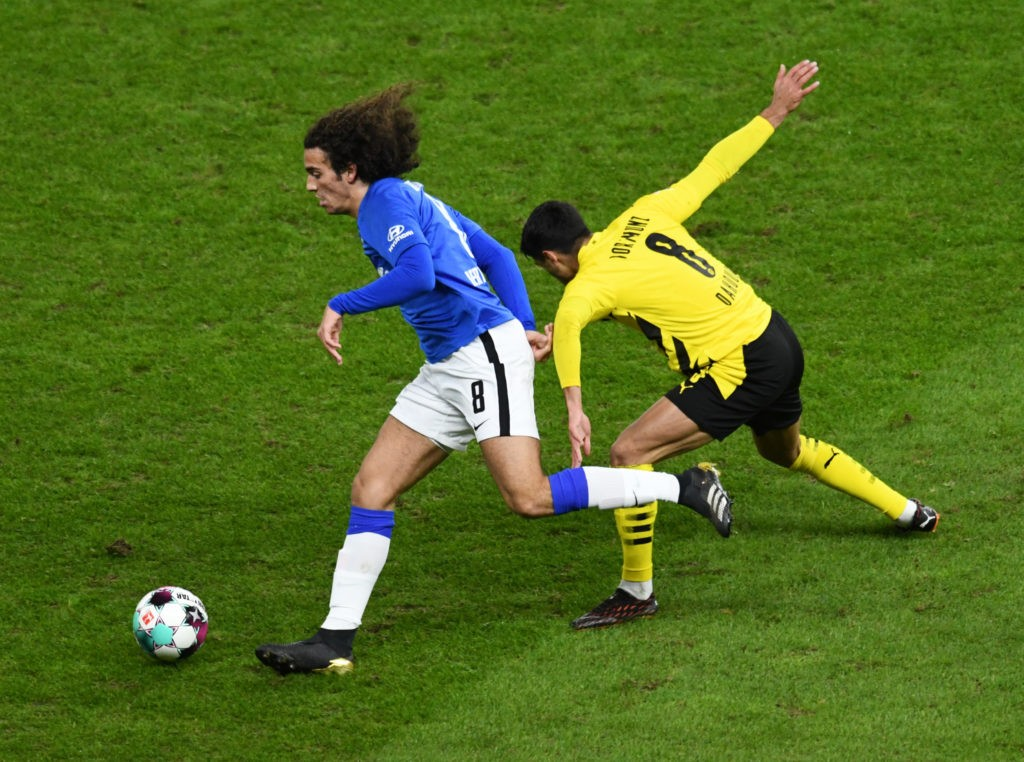 Hertha Berlin's French midfielder Mattéo Guendouzi and Dortmund's German midfielder Mahmoud Dahoud (R) vie for the ball during the German first division Bundesliga football match Hertha BSC Berlin v BVB Borussia Dortmund in Berlin on November 21, 2020. (Photo by ANNEGRET HILSE/POOL/AFP via Getty Images)