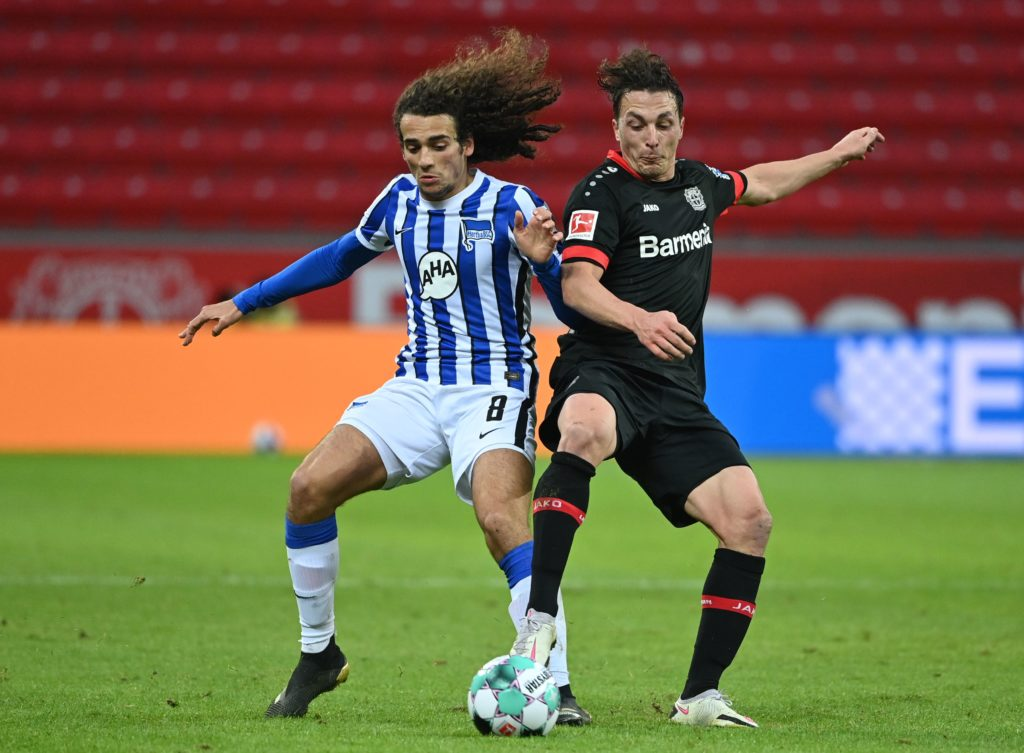 Hertha Berlin's French midfielder Matteo Guendouzi (L) and Leverkusen's Austrian midflielder Julian Baumgartlinger vie for the ball during the German first division Bundesliga football match Bayer Leverkusen v Hertha Berlin on November 29, 2020. (Photo by Ina Fassbender / various sources / AFP)