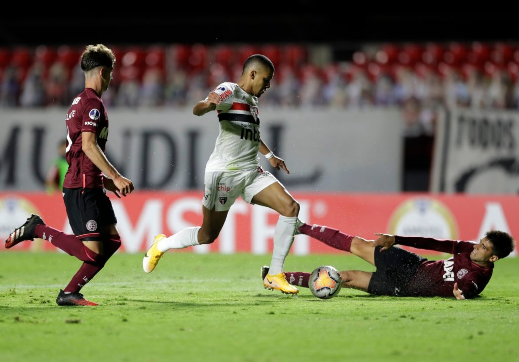 Brazil's Sao Paulo Brenner (C) and Argentina's Lanus Leonel Di Placido (R) vie for the ball during their closed-door Copa Sudamericana second round football match at Morumbi Stadium in Sao Paulo, Brazil, on November 4, 2020. (Photo by ANDRE PENNER/AFP via Getty Images)