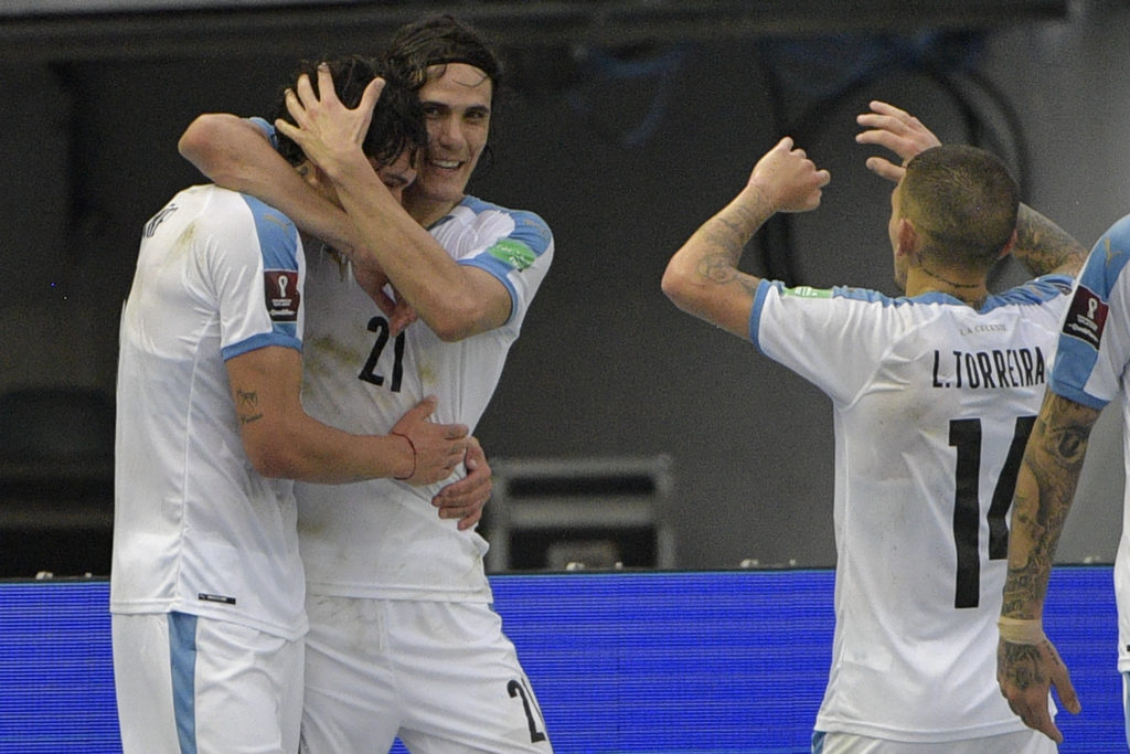 Uruguay's Darwin Nunez (L) celebrates with teammates Uruguay's Edinson Cavani and Lucas Torreira (R) after scoring against Colombia during their closed-door 2022 FIFA World Cup South American qualifier football match at the Metropolitan Stadium in Barranquilla, Colombia, on November 13, 2020. (Photo by RAUL ARBOLEDA/AFP via Getty Images)