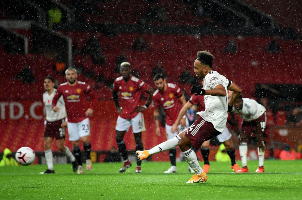MANCHESTER, ENGLAND - NOVEMBER 01: Pierre-Emerick Aubameyang celebrates after scores from the penalty spot during the Premier League match between Manchester United and Arsenal at Old Trafford on November 01, 2020 in Manchester, England. Sporting stadiums around the UK remain under strict restrictions due to the Coronavirus Pandemic as Government social distancing laws prohibit fans inside venues resulting in games being played behind closed doors. (Photo by Shaun Botterill/Getty Images)