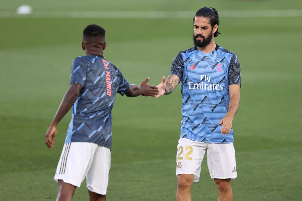 MADRID, SPAIN - JULY 02: Isco (R) and Vinicius Junior of Real Madrid warm up for the Liga match between Real Madrid CF and Getafe CF at Estadio Alfredo Di Stefano on July 02, 2020 in Madrid, Spain. Football Stadiums around Europe remain empty due to the Coronavirus Pandemic as Government social distancing laws prohibit fans inside venues resulting in all fixtures being played behind closed doors. (Photo by Angel Martinez/Getty Images)