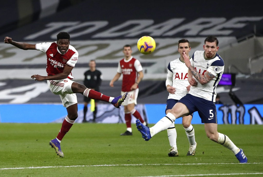 Tottenham Hotspur v Arsenal - Premier League - Tottenham Hotspur Stadium Arsenal's Thomas Partey (left) shoots towards goal during the Premier League match at Tottenham Hotspur Stadium, London. Copyright: Paul Childs