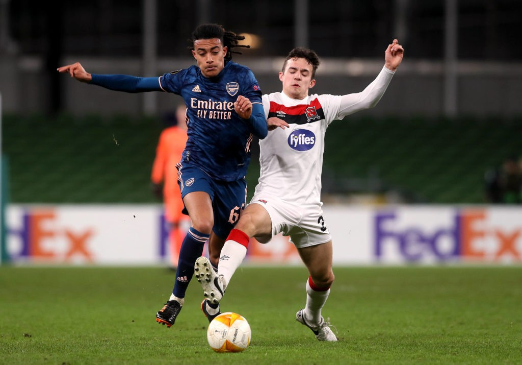 Dundalk v Arsenal - UEFA Europa League - Group B - Aviva Stadium. Arsenal's Miguel Azeez (left) and Dundalk's Jamie Wynne battle for the ball during the UEFA Europa League Group B match at The Aviva Stadium, Dublin. Copyright: Brian Lawless