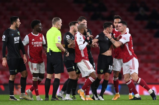 LONDON, ENGLAND - DECEMBER 13: Granit Xhaka of Arsenal grabs Ashley Westwood of Burnley round the throat and is subsequently shown a red card and sent off after a VAR check during the Premier League match between Arsenal and Burnley at Emirates Stadium on December 13, 2020 (Photo by Laurence Griffiths/Getty Images)