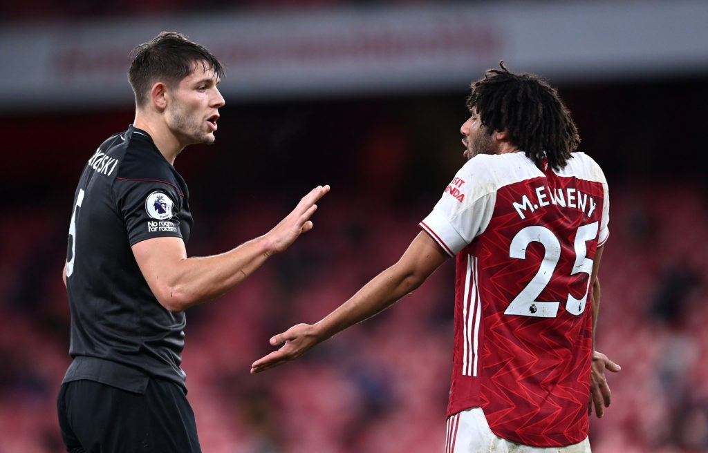 LONDON, ENGLAND - DECEMBER 13: James Tarkowski of Burnley argues with Mohamed Elneny of Arsenal during the Premier League match between Arsenal and Burnley at Emirates Stadium on December 13, 2020 in London, England. A limited number of spectators (2000) are welcomed back to stadiums to watch elite football across England. This was following easing of restrictions on spectators in tiers one and two areas only. (Photo by Laurence Griffiths/Getty Images)