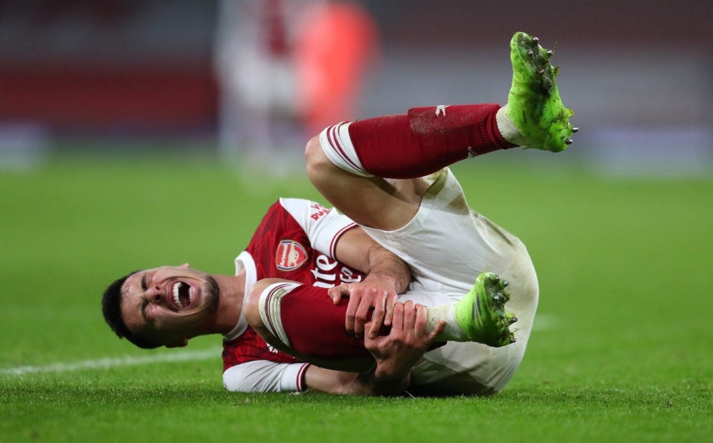 LONDON, ENGLAND - DECEMBER 22: Gabriel Martinelli of Arsenal reacts after picking up an injury during the Carabao Cup Quarter Final match between Arsenal and Manchester City at Emirates Stadium on December 22, 2020 in London, England. The match will be played without fans, behind closed doors as a Covid-19 precaution. (Photo by Catherine Ivill/Getty Images)