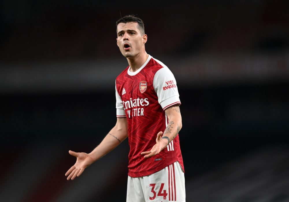 LONDON, ENGLAND - FEBRUARY 21: Granit Xhaka of Arsenal reacts during the Premier League match between Arsenal and Manchester City at Emirates Stadium on February 21, 2021 in London, England. Sporting stadiums around the UK remain under strict restrictions due to the Coronavirus Pandemic as Government social distancing laws prohibit fans inside venues resulting in games being played behind closed doors. (Photo by Shaun Botterill/Getty Images)