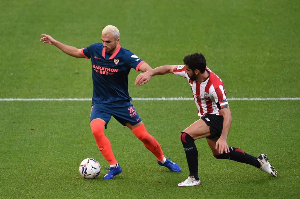 BILBAO, SPAIN: Joan Jordan of Sevilla is challenged by Raul Garcia of Athletic Club during the La Liga Santander match between Athletic Club and Sevilla FC at Estadio de San Mames on October 31, 2020. (Photo by Juan Manuel Serrano Arce/Getty Images)