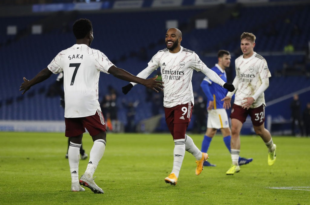 BRIGHTON, ENGLAND - DECEMBER 29: Alexandre Lacazette of Arsenal celebrates with teammate Bukayo Saka after scoring his team's first goal during the Premier League match between Brighton & Hove Albion and Arsenal at American Express Community Stadium on December 29, 2020 in Brighton, England. The match will be played without fans, behind closed doors as a Covid-19 precaution. (Photo by Frank Augstein - Pool/Getty Images)