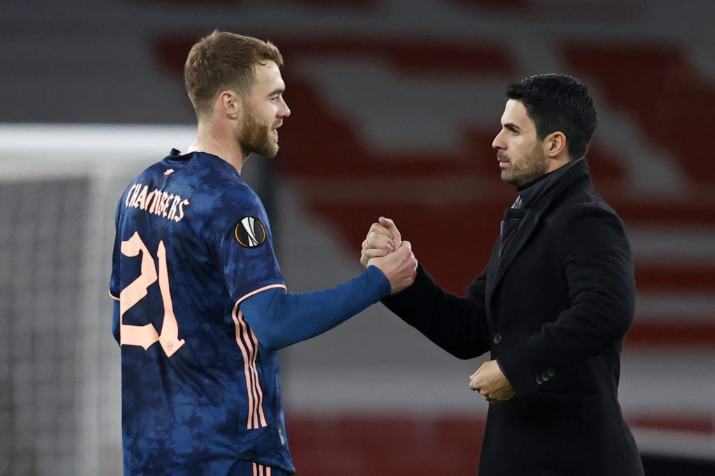 Arsenal's Spanish manager Mikel Arteta congratulates Arsenal's English defender Calum Chambers (L) on the pitch after the UEFA Europa League 1st Round Group B football match between Arsenal and Rapid Vienna at the Emirates Stadium in London on December 3, 2020. - Arsenal won the game 4-1. (Photo by Adrian DENNIS / AFP)