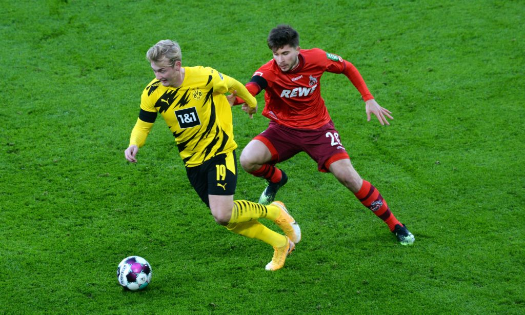 Dortmund's German forward Julian Brandt and Cologne's German midfielder Elvis Rexhbecaj vie for the ball during the German first division Bundesliga football match BVB Borussia Dortmund v 1.FC Cologne at the Signal Iduna Park Stadium in Dortmund, western Germany, on November 28, 2020. (Photo by UWE KRAFT/AFP via Getty Images)
