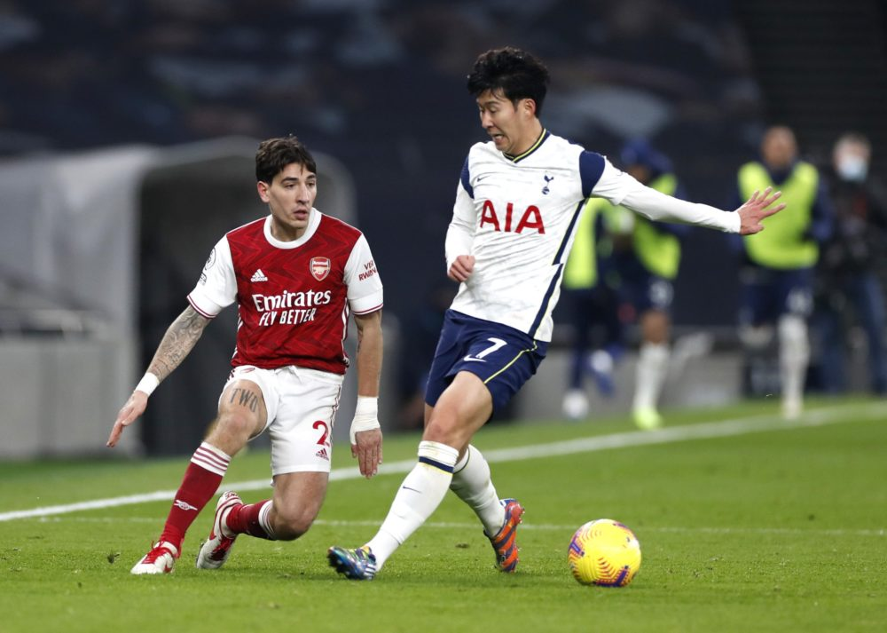 Bellerin foul throw LONDON, ENGLAND - DECEMBER 06: Hector Bellerin of Arsenal is put under pressure by Son Heung-Min of Tottenham Hotspur during the Premier League match between Tottenham Hotspur and Arsenal at Tottenham Hotspur Stadium on December 06, 2020 in London, England. A limited number of fans (2000) are welcomed back to stadiums to watch elite football across England. This was following easing of restrictions on spectators in tiers one and two areas only. (Photo by Paul Childs - Pool/Getty Images)