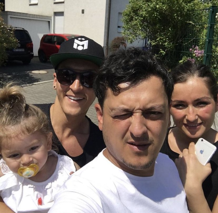 Mesut Özil (2nd from left) with his brother Mutlu (2nd from right)