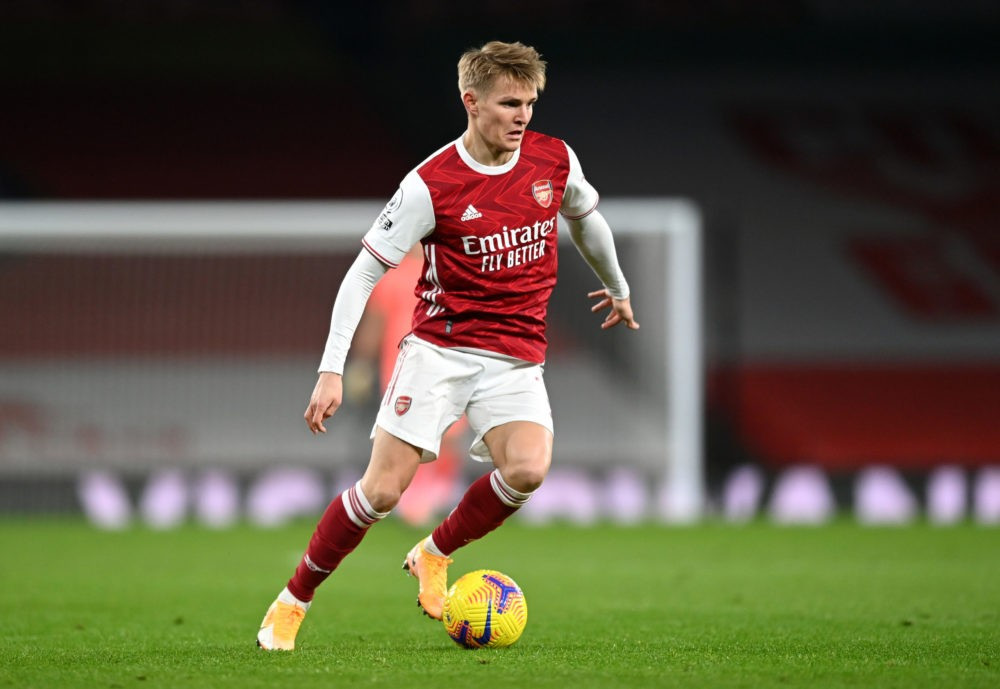 LONDON, ENGLAND: Martin Odegaard of Arsenal runs with the ball during the Premier League match between Arsenal and Manchester United at Emirates Stadium on January 30, 2021. (Photo by Shaun Botterill/Getty Images)