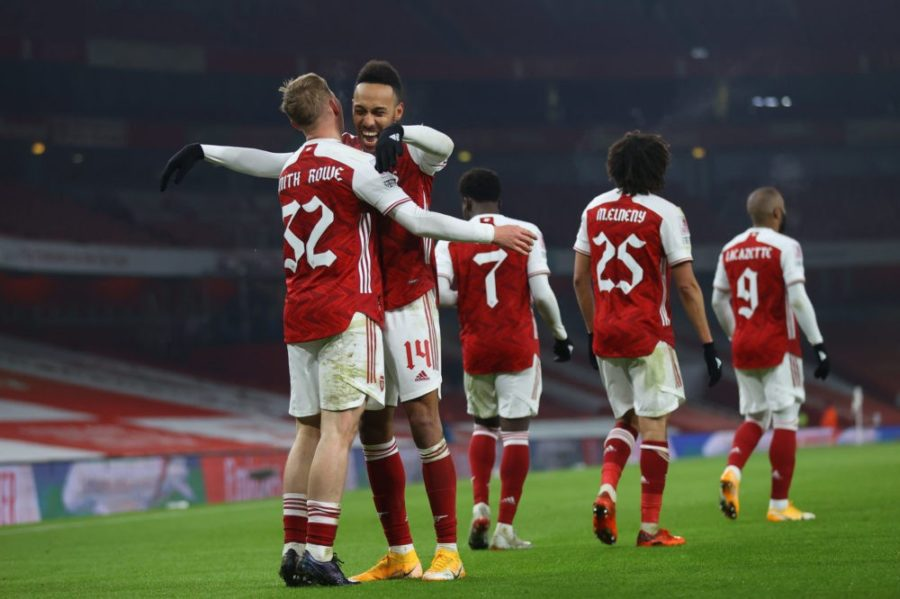 LONDON, ENGLAND - JANUARY 09: Emile Smith Rowe of Arsenal celebrates with teammate Pierre-Emerick Aubameyang after scoring their sides first goal during the FA Cup Third Round match between Arsenal and Newcastle United at Emirates Stadium on January 09, 2021 in London, England. The match will be played without fans, behind closed doors as a Covid-19 precaution. (Photo by Julian Finney/Getty Images)