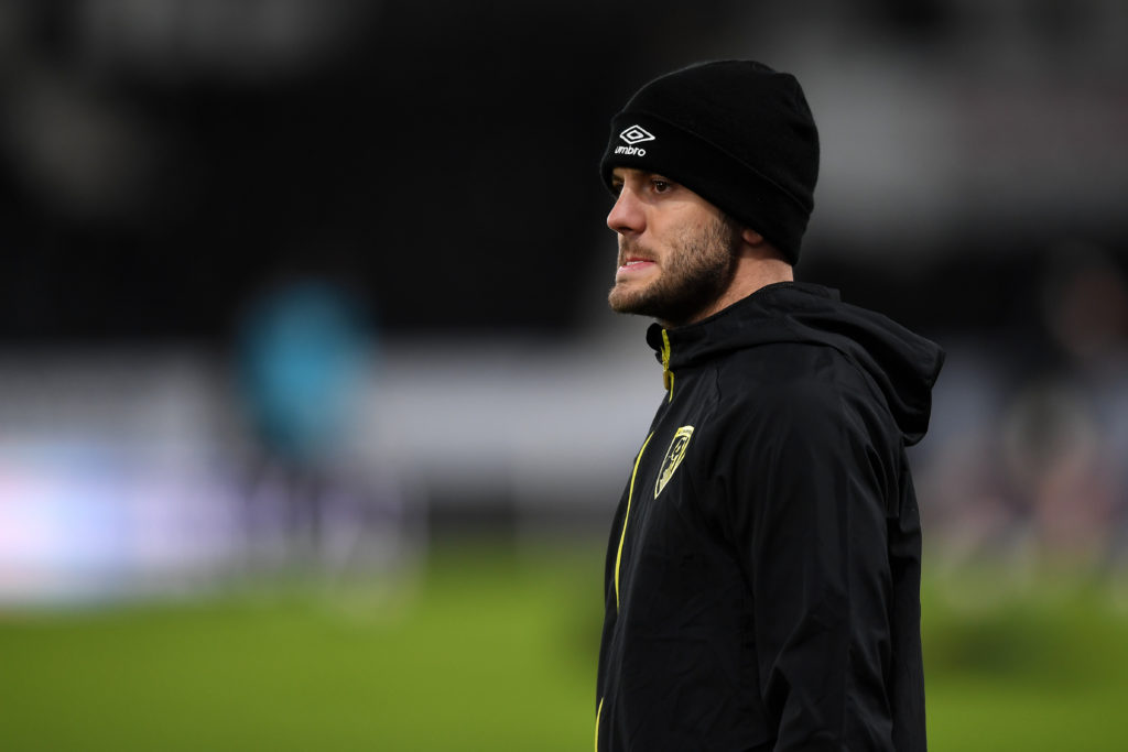 DERBY, ENGLAND - JANUARY 19: Jack Wilshere of AFC Bournemouth looks on during the warm up prior to during the Sky Bet Championship match between Derby County and AFC Bournemouth at Pride Park Stadium on January 19, 2021 in Derby, England. Sporting stadiums around the UK remain under strict restrictions due to the Coronavirus Pandemic as Government social distancing laws prohibit fans inside venues resulting in games being played behind closed doors. (Photo by Gareth Copley/Getty Images)