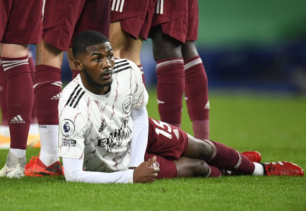 LIVERPOOL, ENGLAND - DECEMBER 19: Ainsley Maitland-Niles of Arsenal lies on the ground as he sets up to defend a free kick during the Premier League match between Everton and Arsenal at Goodison Park on December 19, 2020 in Liverpool, England. A limited number of fans (2000) are welcomed back to stadiums to watch elite football across England. This was following easing of restrictions on spectators in tiers one and two areas only. (Photo by Peter Powell -
