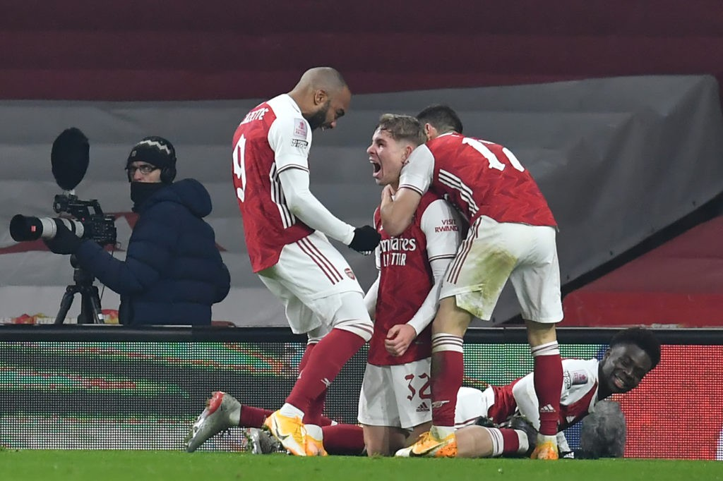 Arsenal's English midfielder Emile Smith Rowe (C) celebrates with teammates after scoring the opening goal of the English FA Cup third round football match between Arsenal and Newcastle United at the Emirates Stadium in London on January 9, 2021. (Photo by Glyn KIRK / AFP)