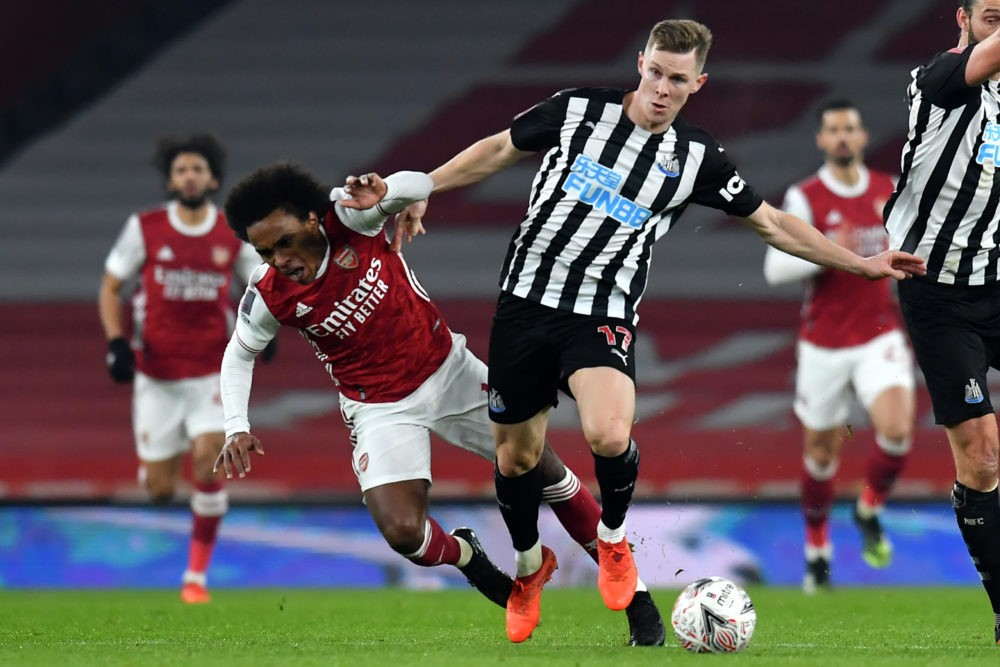 Arsenal's Brazilian midfielder Willian (L) vies with Newcastle United's Swedish defender Emil Krafth (C) during the English FA Cup third round football match between Arsenal and Newcastle United at the Emirates Stadium in London on January 9, 2021. (Photo by Glyn KIRK / AFP)