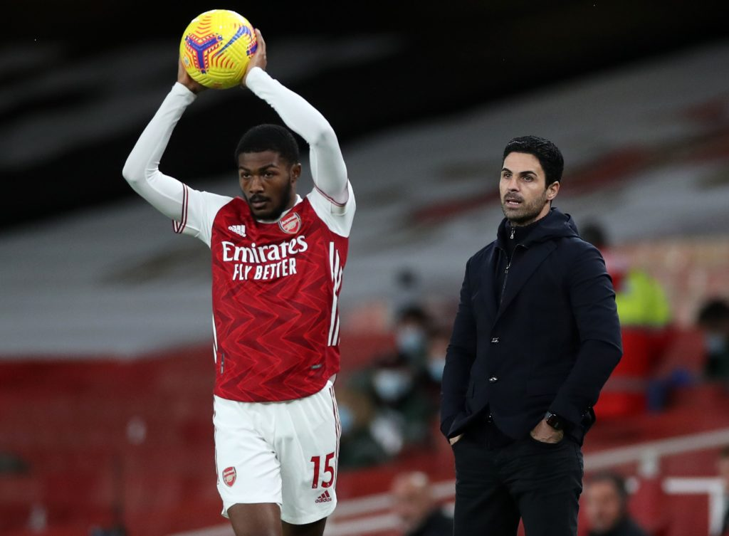 Arsenal's Spanish manager Mikel Arteta (right) watches Arsenal's English midfielder Ainsley Maitland-Niles take a throw-in during the English Premier League football match between Arsenal and Southampton at Emirates Stadium in London on 16 December 2020. (Photo by PETER ZIBORR / POOL / AFP)