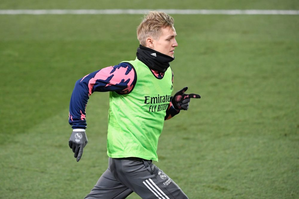 Real Madrid's Norwegian midfielder Martin Odegaard warms up on the sidelines during the Spanish League football match between Real Madrid and Celta Vigo at the Alfredo Di Stefano stadium in Valdebebas, northeast of Madrid, on January 2, 2021. (Photo by OSCAR DEL POZO / AFP)