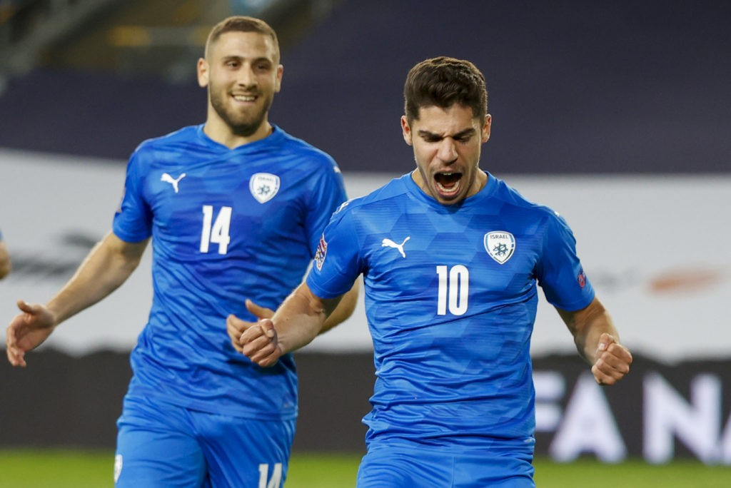 Israel's forward Manor Solomon (R) celebrates after scoring during the UEFA Nations League B Group 2 football match between Israel and Scotland at the Netanya Municipal Stadium in the Israeli city on November 18, 2020. (Photo by JACK GUEZ / AFP)