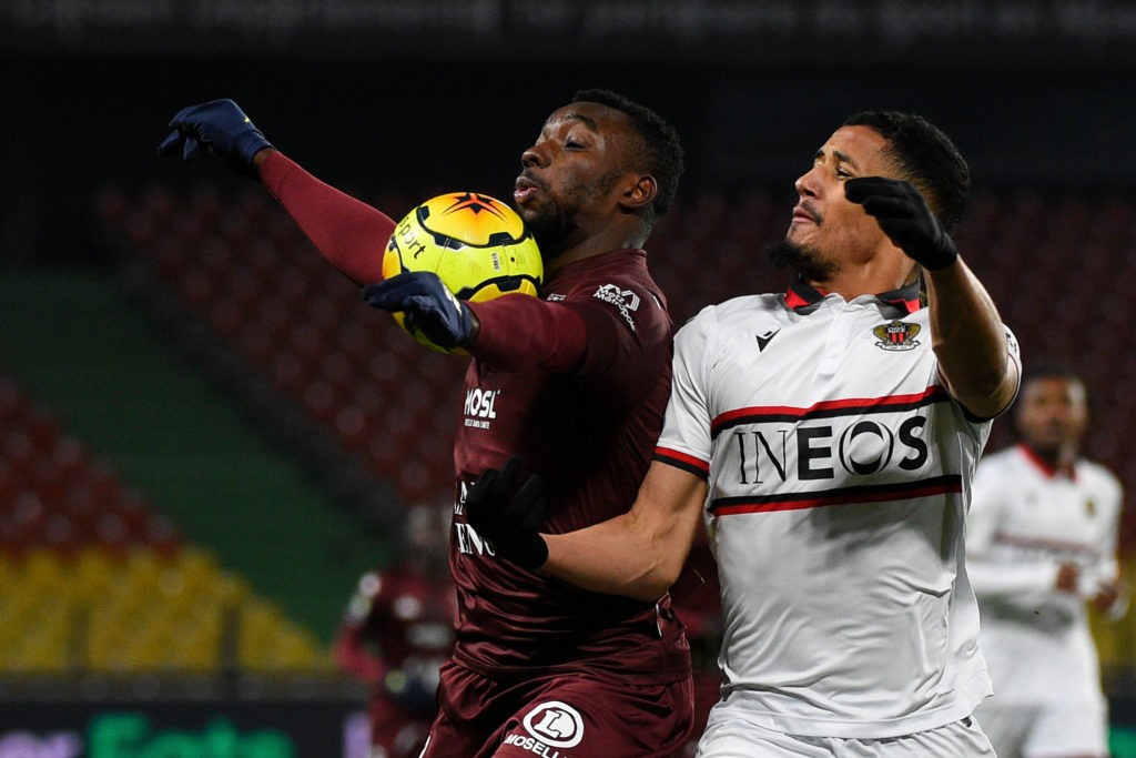 Nice's French defender William Saliba (L) challenges Metz's French forward Thierry Ambrose during the French L1 football match between Football Club de Metz and OGC Nice at the Saint-Symphorien Stadium in Longeville-Les-Metz, eastern France on January 9, 2021. (Photo by JEAN-CHRISTOPHE VERHAEGEN/AFP via Getty Images)