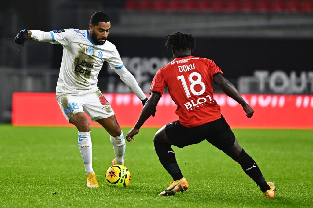 Marseille's French defender Jordan Amavi (L) fights for the ball with Stade Rennais Belgian forward Jeremy Doku during the French L1 football match between Rennes (Stade Rennais) and Marseille (OM), at the Roazhon Park stadium in Rennes, western France, on December 16, 2020. (Photo by DAMIEN MEYER/AFP via Getty Images)