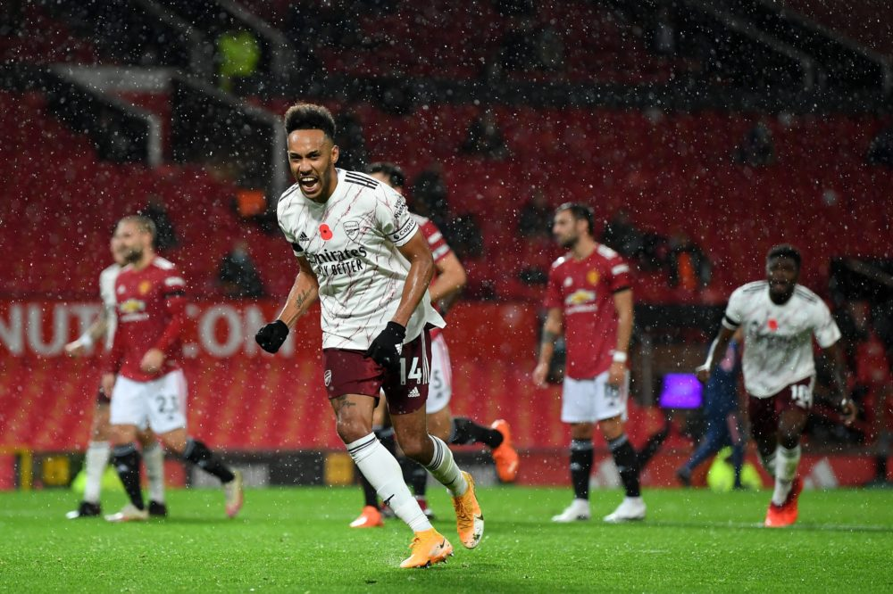 MANCHESTER, ENGLAND - NOVEMBER 01: Pierre-Emerick Aubameyang celebrates after scoring from the penalty spot during the Premier League match between Manchester United and Arsenal at Old Trafford on November 01, 2020 in Manchester, England. Sporting stadiums around the UK remain under strict restrictions due to the Coronavirus Pandemic as Government social distancing laws prohibit fans inside venues resulting in games being played behind closed doors. (Photo by Shaun Botterill/Getty Images)