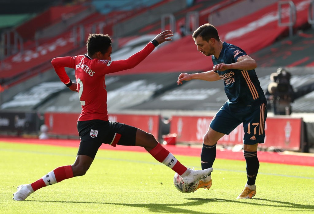 SOUTHAMPTON, ENGLAND: Cedric Soares of Arsenal is challenged by Kyle Walker-Peters of Southampton during The Emirates FA Cup Fourth Round match between Southampton FC and Arsenal FC on January 23, 2021. (Photo by Catherine Ivill/Getty Images)