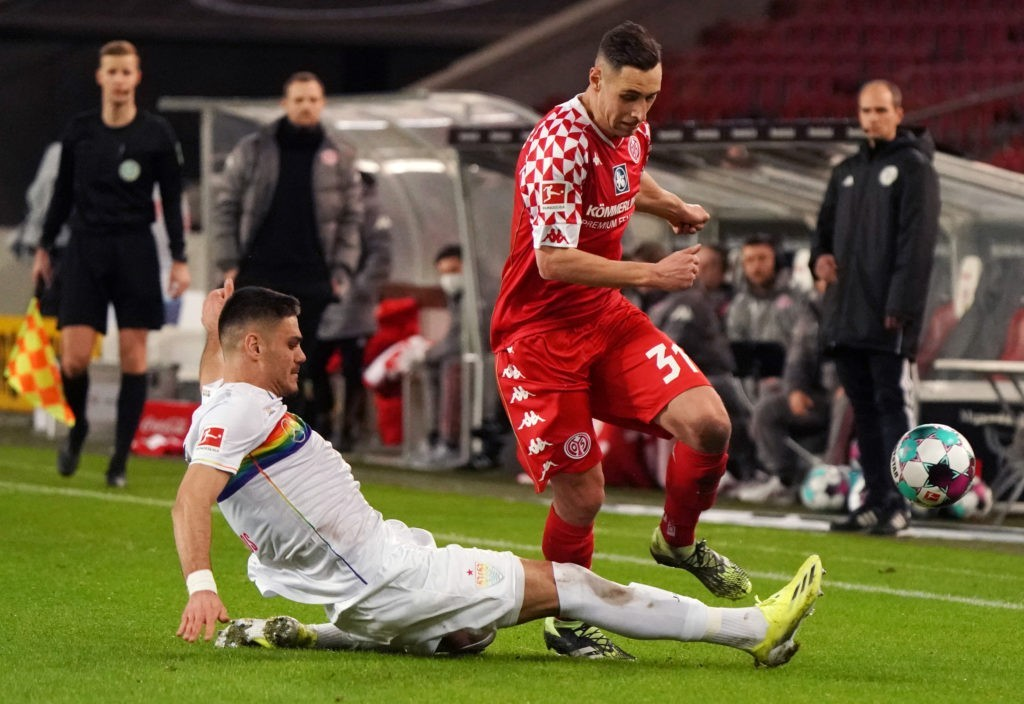 STUTTGART, GERMANY: Dominik Kohr of Mainz is challenged by Konstantinos Mavropanos of Stuttgart during the Bundesliga match between VfB Stuttgart and 1. FSV Mainz 05 at Mercedes-Benz Arena on January 29, 2021. (Photo by Thomas Niedermueller / Getty Images)