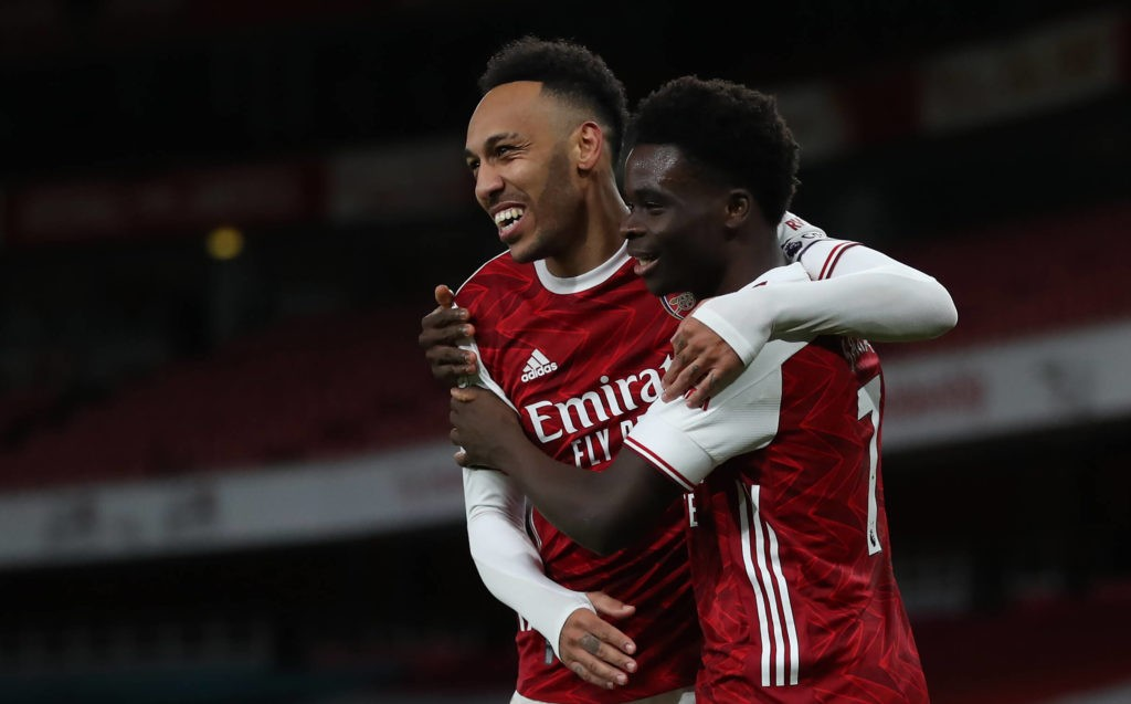 Arsenal's Bukayo Saka with Pierre-Emerick Aubameyang. Issue date: Monday February 15, 2021. Copyright: Catherine Ivill