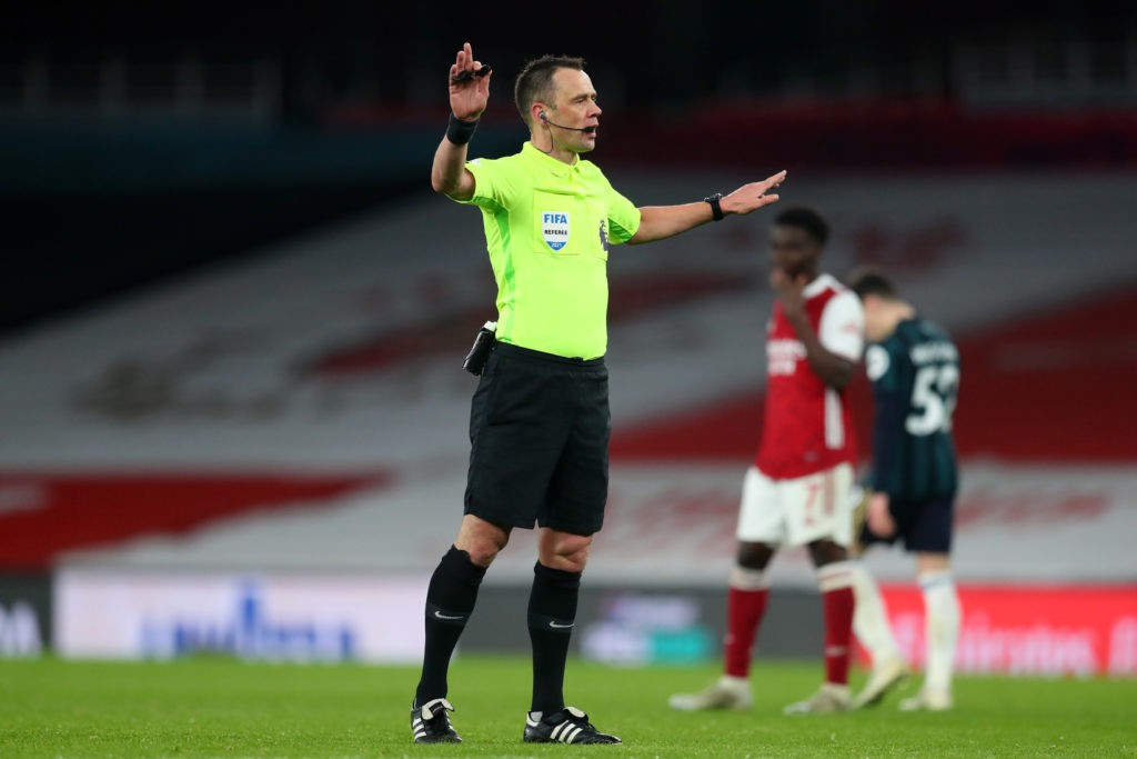 LONDON, ENGLAND: Referee, Stuart Attwell gestures during the Premier League match between Arsenal and Leeds United at Emirates Stadium on February 14, 2021. (Photo by Catherine Ivill/Getty Images)