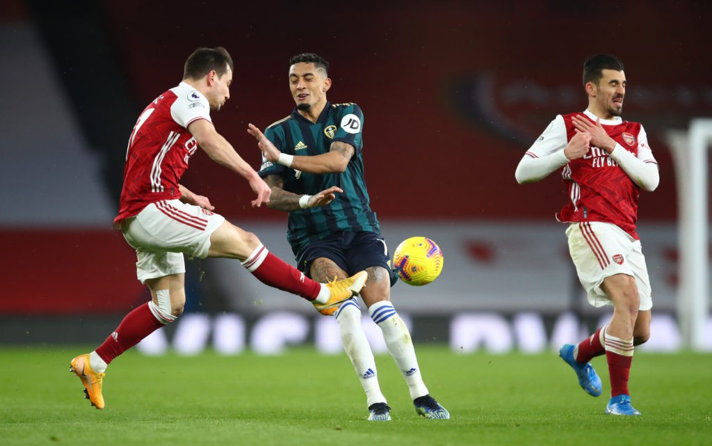LONDON, ENGLAND: Cedric Soares of Arsenal is challenged by Raphinha of Leeds United during the Premier League match between Arsenal and Leeds United at Emirates Stadium on February 14, 2021. (Photo by Julian Finney/Getty Images)