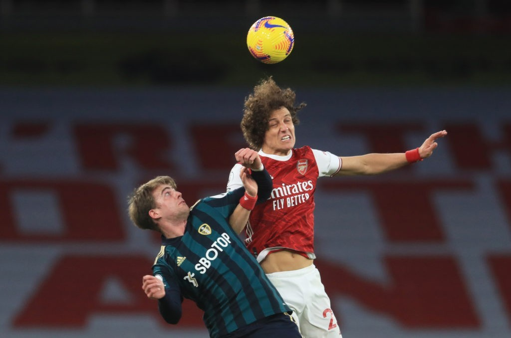 LONDON, ENGLAND - FEBRUARY 14: David Luiz of Arsenal wins a header over Patrick Bamford of Leeds United during the Premier League match between Arsenal and Leeds United at Emirates Stadium on February 14, 2021 in London, England. Sporting stadiums around the UK remain under strict restrictions due to the Coronavirus Pandemic as Government social distancing laws prohibit fans inside venues resulting in games being played behind closed doors. (Photo by Adam Davy - Pool/Getty Images)