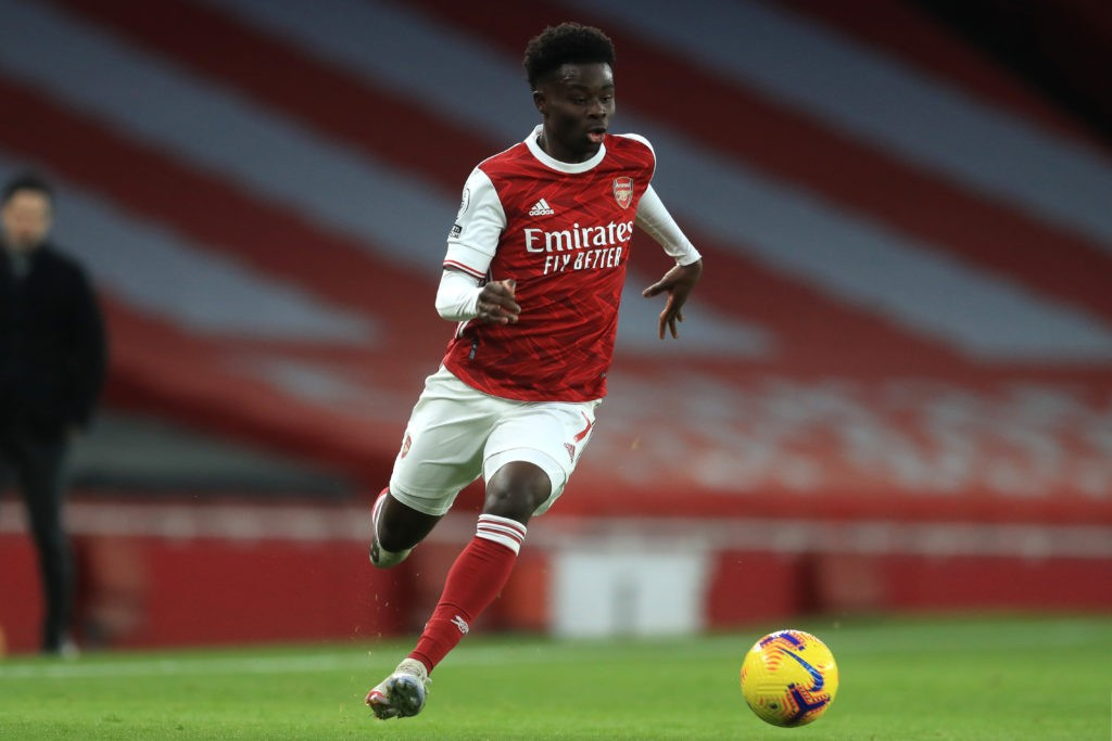 LONDON, ENGLAND: Bukayo Saka of Arsenal runs with the ball during the Premier League match between Arsenal and Leeds United at Emirates Stadium on February 14, 2021. (Photo by Adam Davy - Pool/Getty Images)